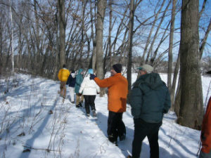 Photo of people walking on River Trail in winter